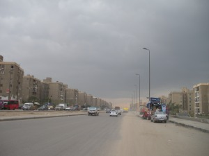 A large road passes through housing development in the Haygana area of Cairo