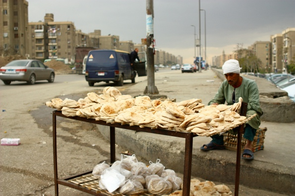 A vendor sells bread in Cairo (Photo Credit: Cairo from Below)