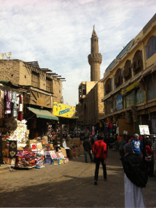 "One can see a minaret and a mosque whose roof is damaged and disappears between the neighboring buildings. The contrast is obvious between the more ""glamorous"" parts of Al-Mu'izz street and its second half, which is cut by Al-Azhar street. All of this area is protected area under World Heritage Site regulations. Photo: LP"